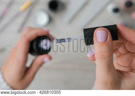 Modern Female Nude Design Manicure. Nail Care, Self Care. Professional Hardware Manicure. Procedure