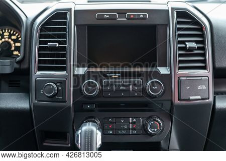 Modern Car Interior With Multimedia Display And Dashboard. View From Inside A Car.
