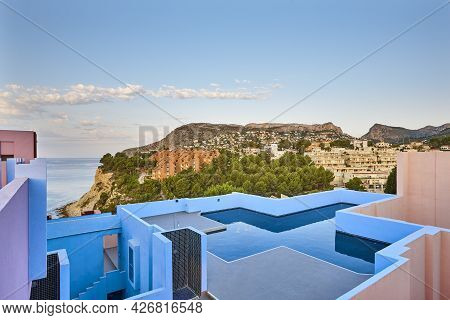 Geometric Colored Building Design. Swimming Pool. Red Wall. Calpe, Spain