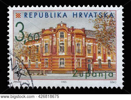 ZAGREB, CROATIA - SEPTEMBER 03, 2014: A stamp printed in Croatia shows Town Hall in Zupanja, Series Croatian Towns, circa 1995