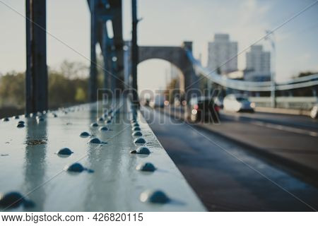 Rivet As A Detail Of An Old Suspension Bridge And City Road In Perspective On A Background, Urban Co