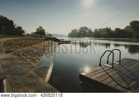 Place For People Meeting Or Gathering Place In A City On A River With Wooden Platform And Handrails