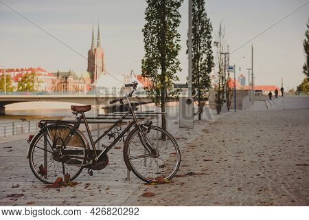 Bicycle On A City Street. City Bicycle, Retro Cycling In Town, Old Retro Bike, Cycling Or Commuting