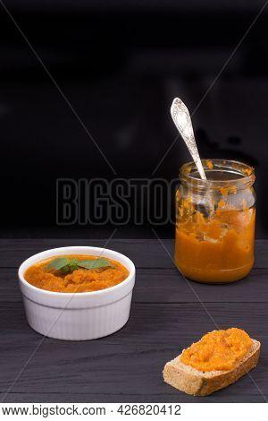 Dish With Squash Caviar Decorated With Basil On A Black Background. Squash Spread, Zucchini Caviar A