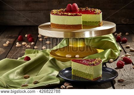 Sliced Mousse Pistachio Cake With Raspberry Jelly And Fresh Raspberries