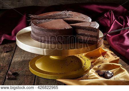 Sliced Chocolate Sponge Cake With Chocolate Buttercream And Icing