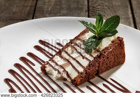 Slice Of Cheesecake On Chocolate Shortcrust Pastry With Poached Pear