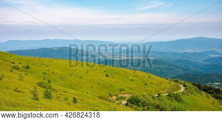 Country Road Through The Hill. Mountain Landscape In Morning Light. Blue Sky With Clouds On A Horizo