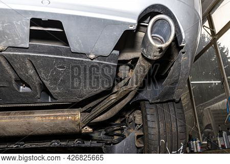 The Exhaust System In The Car Seen From Below, Visible End Silencer And Wheel, The Car Is On The Lif