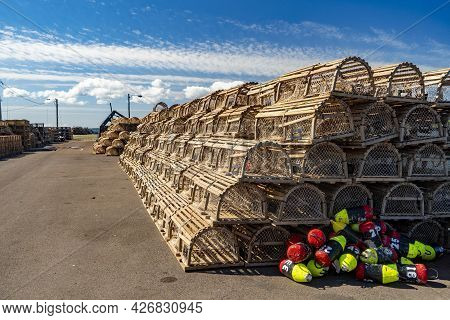 Lobster Traps Piled On A Wharf In Rural Prince Edward Island, Canada.