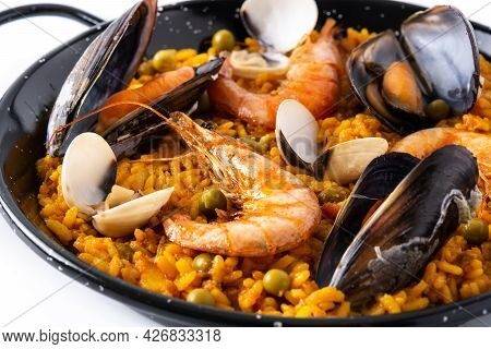 Traditional Spanish Seafood Paella Isolated On White Background. Close Up
