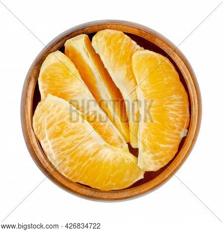Orange Segments, In A Wooden Bowl. Segments Of A Peeled Valencia Orange. A Ripe And Sweet Fruit With