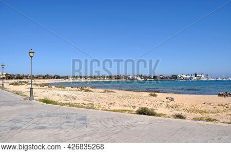 View Of The Beach And The Bay With Blue Ocean Water In Castillo,caleta De Fuste,fuerteventura,canary