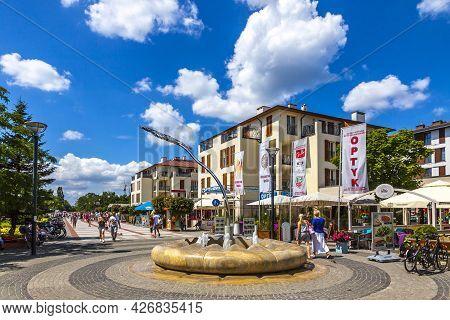 Swinoujscie, Poland - July 2019: People Walking Across Promenade Street In Swinoujscie. Most Famous
