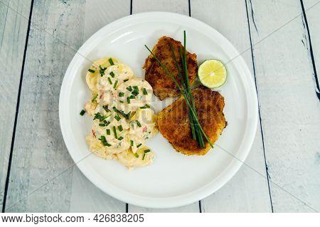 Red Snapper Sebastes Norvegicus Fish Filet And Potato Salad