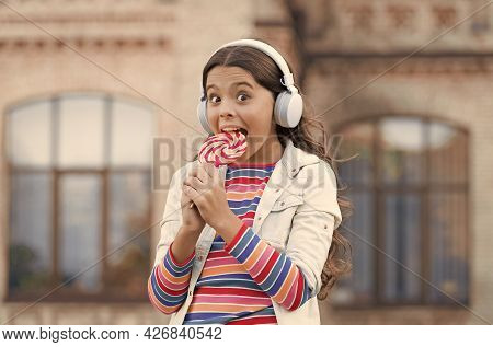Sweet Dreams. Healthy Food. Child Has Music Break. Girl In Headphones. Little Girl In Wireless Heads