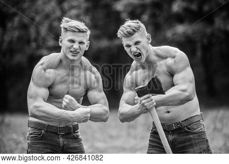 Handsome Brothers. Strong Men Nature Background. Group Muscular Men With Axe. Athletic Twins Use Ax.