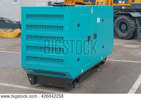 Emergency Electric Power Generator Outside At Parking Lot