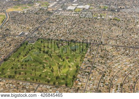 Flight On An Airplane Over Mix Of Residential, Industrial City Phoenix Arizona Us