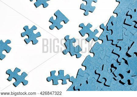 Jigsaw Puzzles  On White Background, Partially Assembled Mosaic, Many Pieces Of Jigsaw Puzzles, The