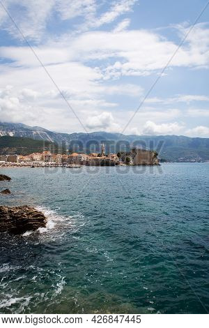Montenegro, Budva, Very Beautiful View Of The Old Town And Citadel In Budva. Beautiful Clouds On A W