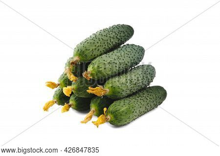 Stack Of Cucumbers In The Shape Of A Pyramid Isolated On White.