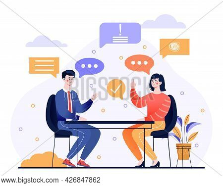 Talk Conversation And Speaking Dialogue Concept. A Man And A Woman Are Sitting At A Table, Discussin