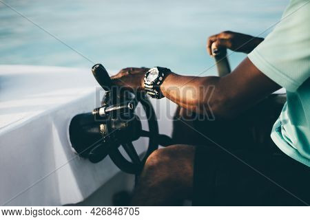 A Close-up View Of A Hand With The Watch Of A Black Adult Guy Turning The Steering Wheel While Drivi