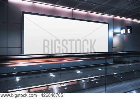 A Huge Rectangular Empty Billboard Mockup Next To Travelator In A Modern Airport Departure Area; A W