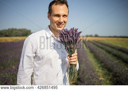Stuning Portrait Of Farmer In Lavender Field On Sunset
