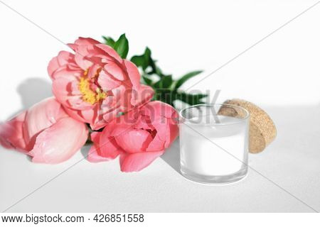 White Scented Candle And Red Peony Flowers. Home Fragrances For Cozy Atmosphere. Flower Fragrance Fo