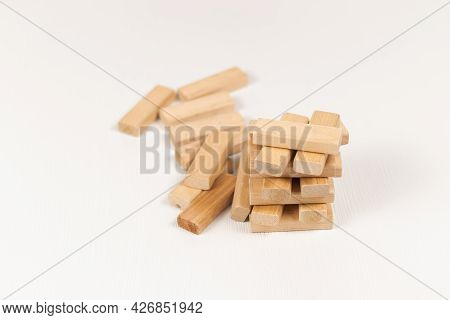 Constructor Game From Wooden Blocks On A White Wooden Table. Selective Focus. Close-up