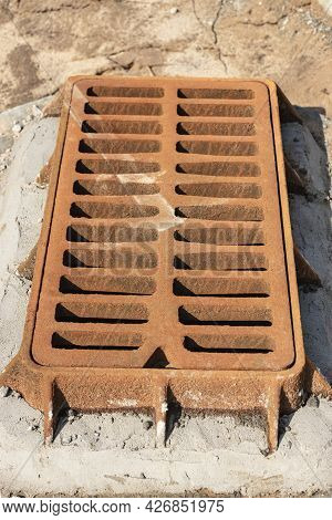 Storm Sewer Road Hatch. Close-up. Road Works. Collection And Disposal Of Rainwater From The Street