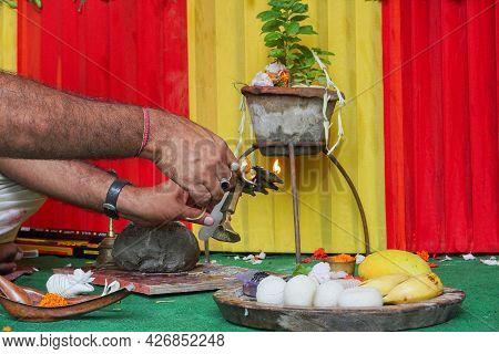 Hindu Priest Lighting Up Holy Fire Or Holy Light For Worshipping Idol Of God Jagannath, Balaram And