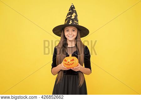 This Is Mine. Costume Party Fun. Jack O Lantern. Happy Halloween. Child In Witch Hat. Kid Hold Spook