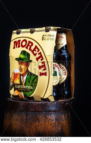 6 Pack Of Birra Moretti Beer On Wooden Barrel With Dark Background. Illustrative Editorial Photo Buc