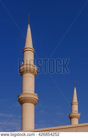 Minaret Of A Muslim Islamic Mosque On The Background Of The Blue Sky. Minaret Tower With Traditional