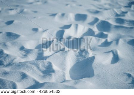 Soft textured white snow-covered ground