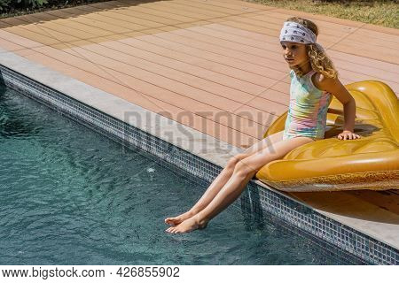 Young Girl In Fashionable Swimwear Sunbathing Near Swimming Pool In Summer. Beautiful Young Model Si