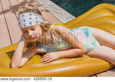 Young Girl In Fashionable Swimwear Sunbathing Near Swimming Pool In Summer. Beautiful Young Model Li