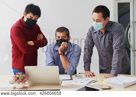 Businessmen Wearing Protective Masks Discussing And Work Together In Meeting Room. Social Distance P