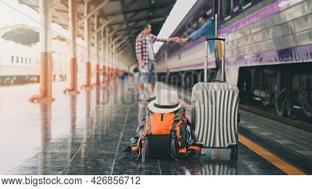 Backpack, Luggage And Hat Over Travellers At Train Station. Travel Concept.