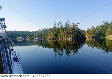 A Point Of View From Someone In A Boat Looking Out At A Beautiful Cove With Boats Anchored Surrounde