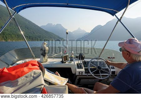 Jervis Inlet, Sunshine Coast, British Columbia, Canada - June 30th, 2021: A Man Driving His Boat On