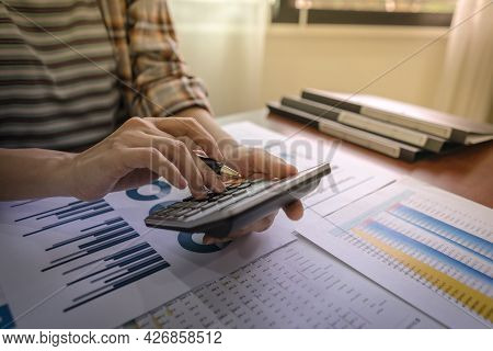 Close Up Of Businesswoman Or Accountant Using Calculator For Do Math Finance, Dedicated To The Progr