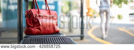 Lost Woman Bag Or Purse At Busstop In Transit