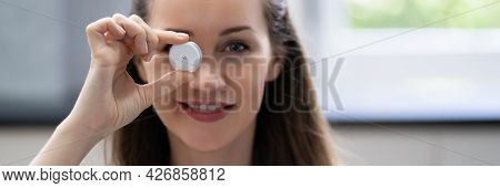 Woman Holding Continuous Glucose Monitor For Testing Glucose Level