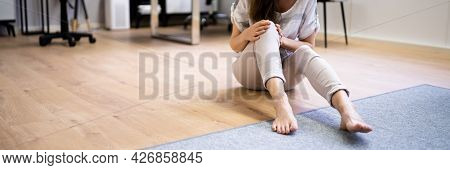 Slip And Fall Accident. Woman Lying Down On Slippery Floor