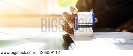African American Black Woman Using Notary Stamp On Official Paper