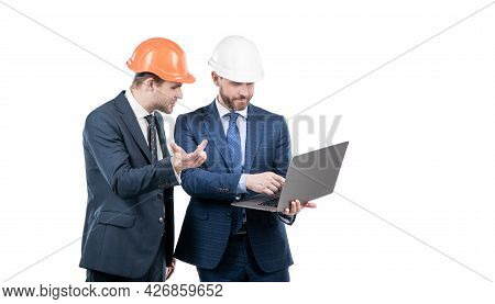 Two Businesspeople Partners In Safety Helmet Working On Laptop Online Copy Space, Business Partners.